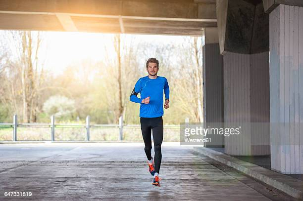 Young sporty man jogging
