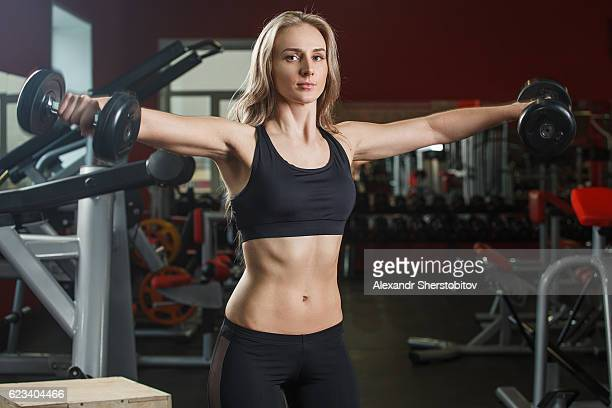 young sporty woman exercise with dumbells
