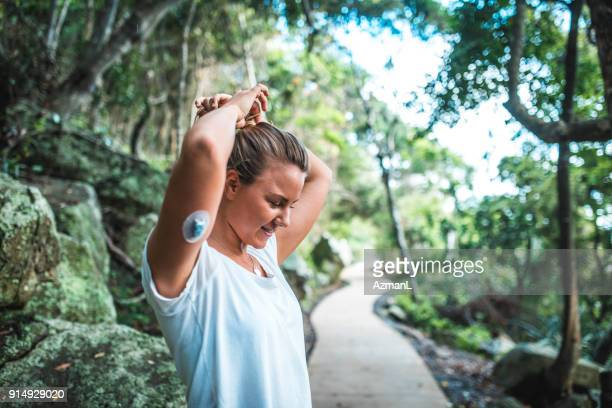 young sporty woman getting ready for training - insulin stock pictures, royalty-free photos & images