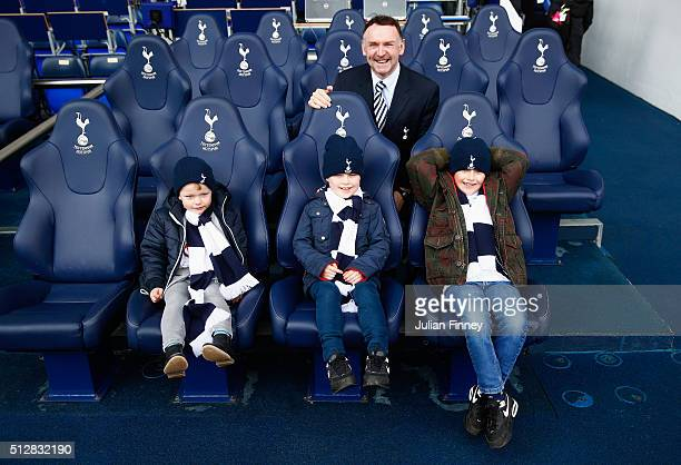 Young Spurs fans sit in the Tottenham Hotspur dug out prior to the Barclays Premier League match between Tottenham Hotspur and Swansea City at White...