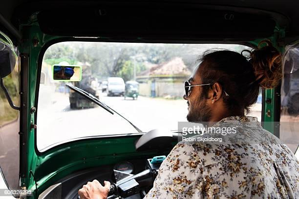 Young Sri Lankan Man driving TuK Tuk