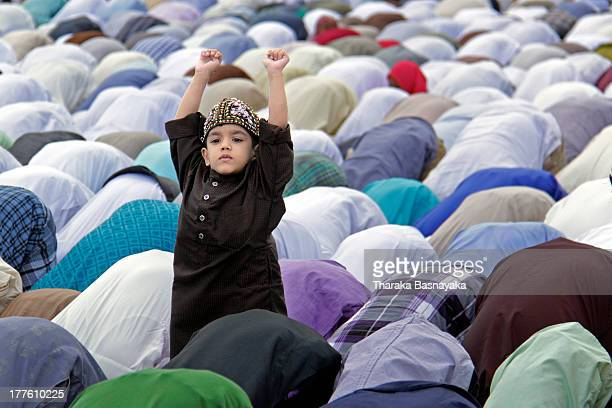 CONTENT] A young Sri Lankan Muslim child gestures as special prayers are performed during celebrations of the Eid alFitr festival in Galle Face Green...