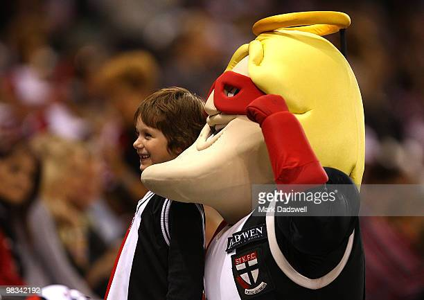 A young St Kilda fan is photographed with the Saints mascot during the round three AFL match between the St Kilda Saints and the Collingwood Magpies...