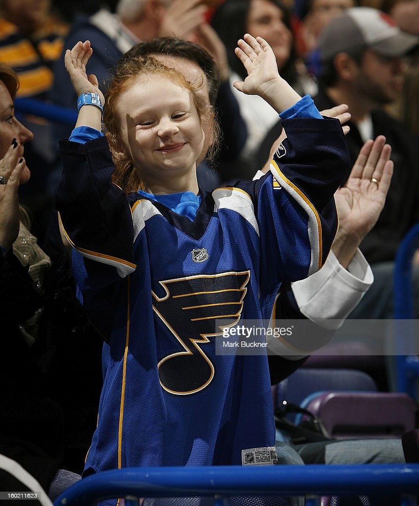 A young St. Louis Blues fan enjoys the action in an NHL game between the St. Louis Blues and the Minnesota Wild on January 27, 2013 at Scottrade Center in St. Louis, Missouri.