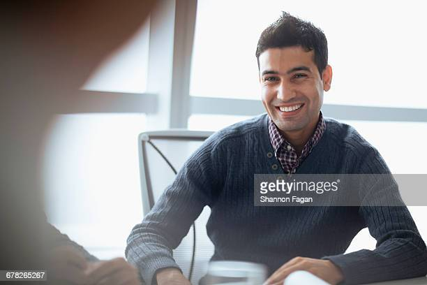 young staff member at meeting in office - handsome pakistani men - fotografias e filmes do acervo