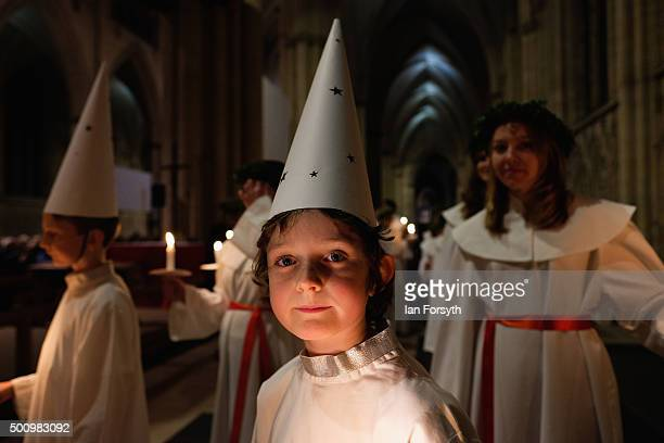 Young 'Starboy' from the Vaxholms boys choir waits for the start of the traditional Swedish festival of Sankta Lucia in York Minster on December 11...