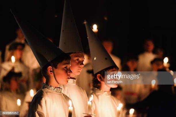 Young 'Starboys' from the Vaxholms boys choir sing during the traditional Swedish festival of Sankta Lucia in York Minster on December 11 2015 in...