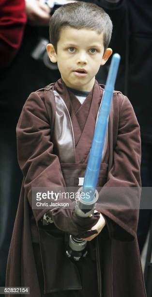 A young Stars Wars fan dressed as Luke Skywalker is seen watching the Royal Philharmonic Orchestra performing the score to The Star Wars Movie in...