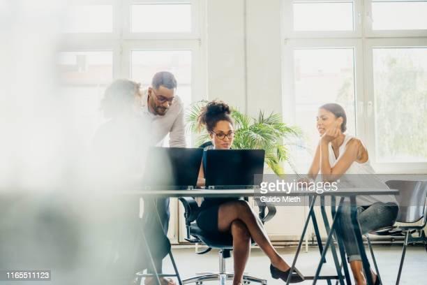 young start up business meeting in a modern office. - imagem superexposta - fotografias e filmes do acervo