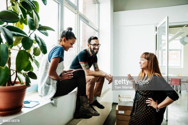 young start up business people having an informal meeting - fringe dress stock pictures, royalty-free photos & images