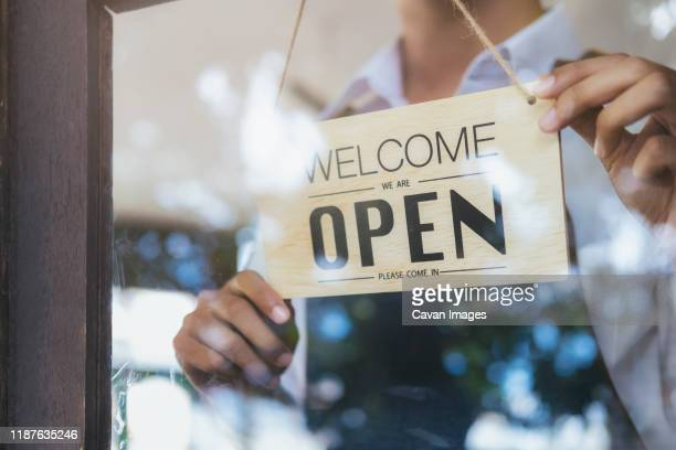 young startup coffee cafe owener open and welcome customer. - loja imagens e fotografias de stock