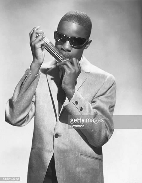 A young Stevie Wonder playing a harmonica in the 1960's