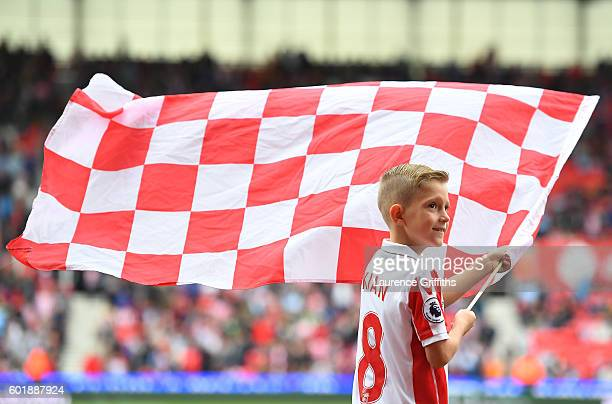 A young Stoke flag bearer is seen prior to kickoff during the Premier League match between Stoke City and Tottenham Hotspur at Britannia Stadium on...
