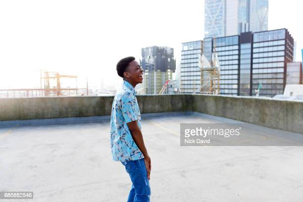 young street dancer on a london rooftop overlooking the city. - lol stock photos and pictures