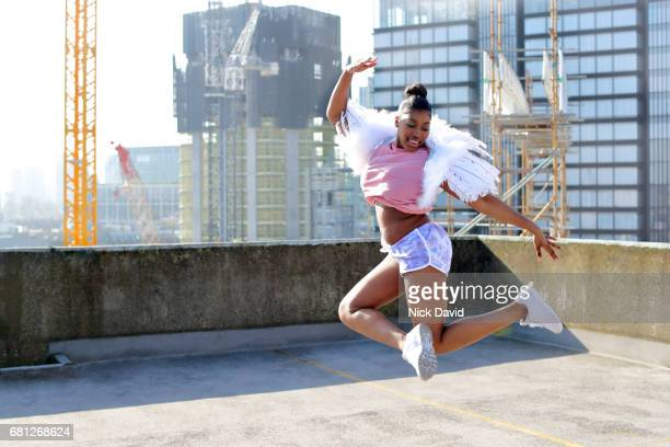 young street dancer on london rooftop overlooking the city - dancing stock pictures, royalty-free photos & images