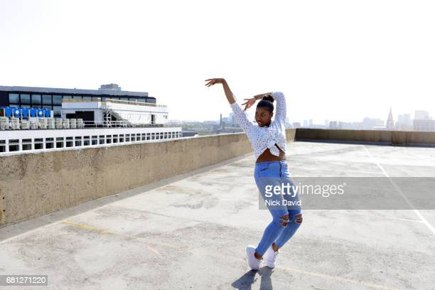 Young street dancers on London rooftop overlooking the city