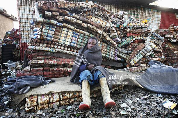 Young street kid sits on a matteress made from tin cans in Maseru on July 9, 2008 in Maseru, Lesotho. Street children in Mesuru are one of the...