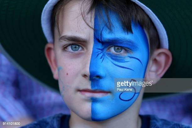A young Strikers fan shows his support during the Big Bash League Final match between the Adelaide Strikers and the Hobart Hurricanes at Adelaide...