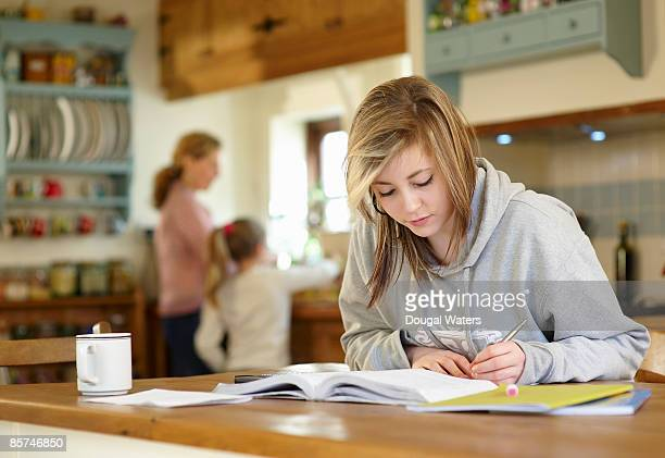Young student doing homework.