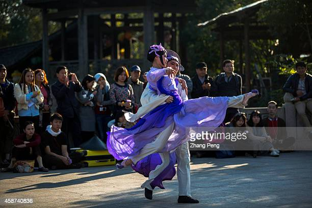 WUZHEN TONGXIANG ZHEJIANG CHINA Young student from China Central Academy of Drama are performing the classic opera 'Mudanting' on a square under the...