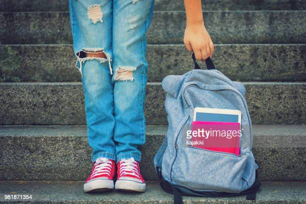 young student girl with backpack - rucksack stock pictures, royalty-free photos & images