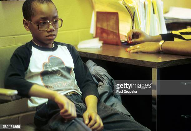 A young student looks down while undergoing counseling by a teacher during a school program at the LeClaire Courts a West Side public housing complex...