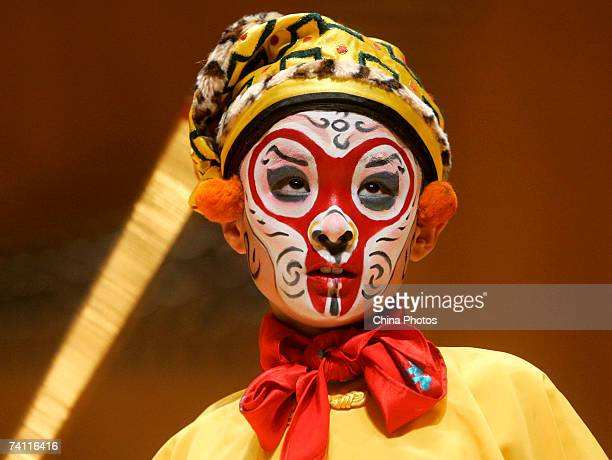 A young student performs as the Monkey King at the Peking Opera on stage to celebrate the 20th annivisary of the Jinfan Chorus on May 9 2007 in...