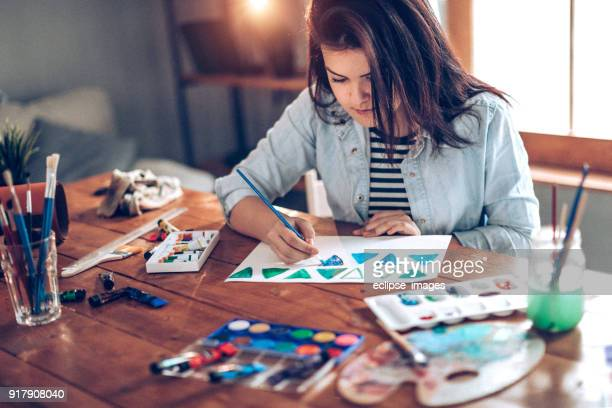 Young student preparing for art school