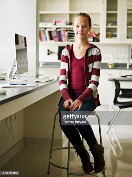 Young student sitting at computer in classroom