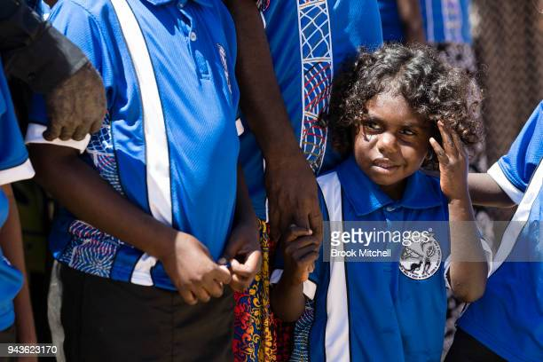 A young student waits to greet the Prince Charles Prince of Wales on April 9 2018 in Gove Australia The Prince of Wales and Duchess of Cornwall are...