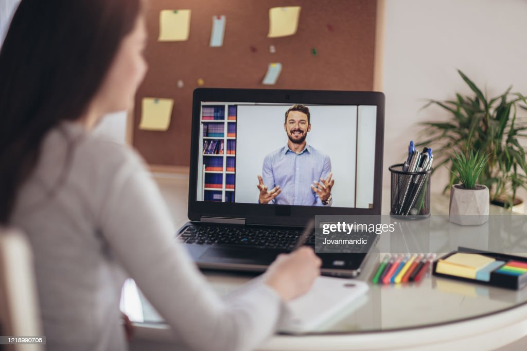 Young student watching lesson online and studying from home. : Stock Photo