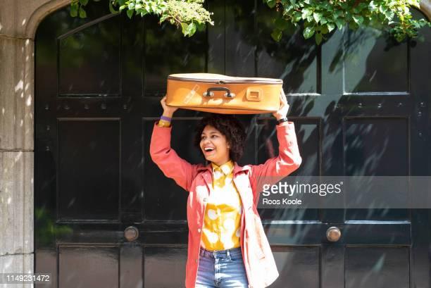 a young student with a suitcase - printemps humour photos et images de collection