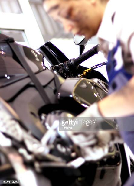 young student working on motorbike - mechatronics stock pictures, royalty-free photos & images