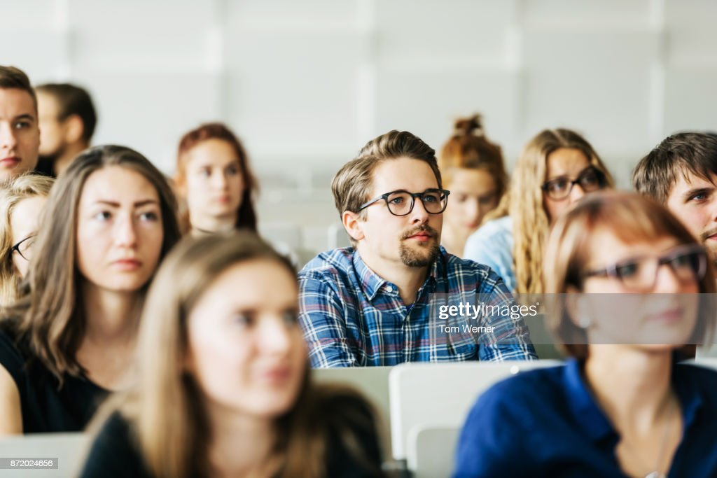 Young Students Concentrating On Professor During Lecture : Stock Photo