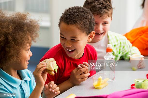 young students finding lunchtime funny - lunch stock pictures, royalty-free photos & images