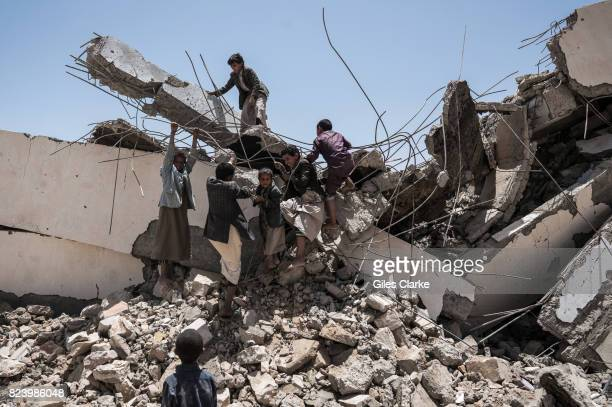 Young students play in the ruins of the Aal Okab school destroyed during the conflict in June 2015 Students now attend lesson in UNICEF tents nearby...