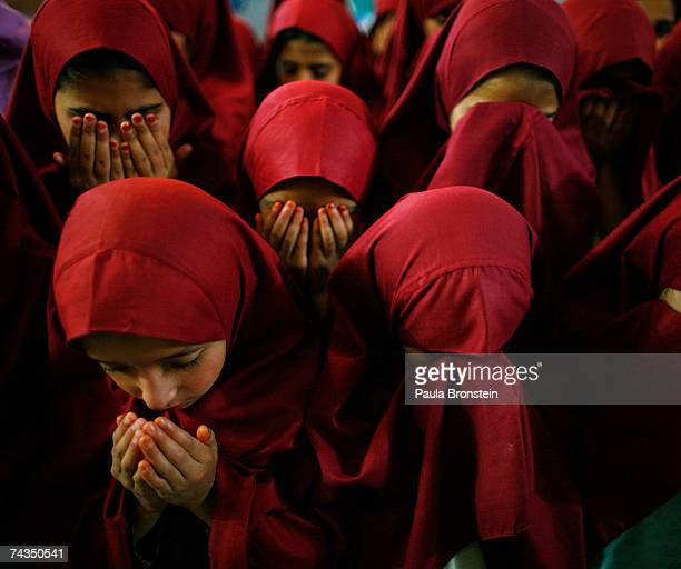 Young students pray at the Jamia Hafsa women's madrassa inside the compound of the Lal mosque on May 28 2007 in Islamabad Pakistan The Jamia Hafsa...