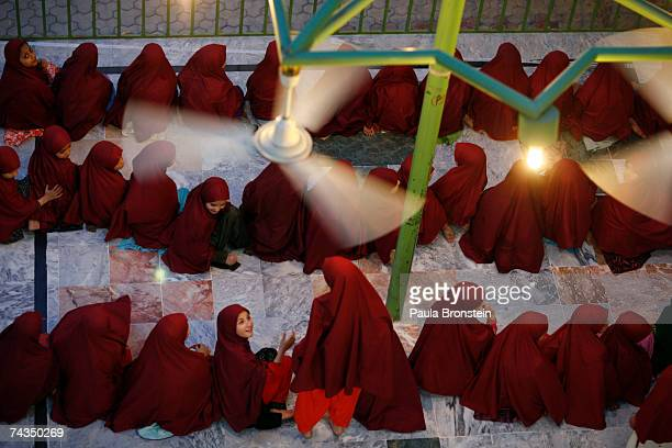 Young students sit in the atrium during the evening prayer at the Jamia Hafsa women's school or Madrassa inside the compound of the Lal mosque on May...