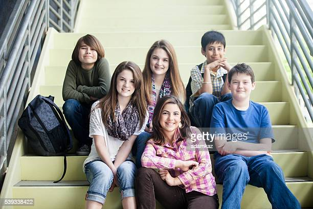 Young Students Sitting Together on Staircase