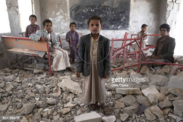 APRIL Young students stand in the ruins of a former classroom of the Aal Okab school Located in the outskirts of Saada City the school was destroyed...