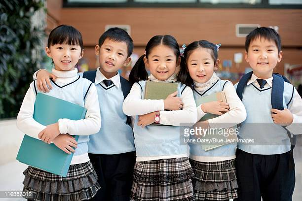 Young students standing in a row at school