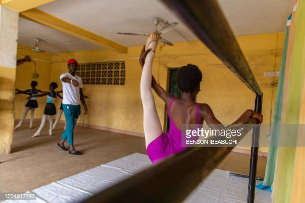 Young Students stretches during rehearsals at the Leap of Dance Academy in Ajangbadi, Lagos, on July 3, 2020. - The Leap of Dance Academy is a ballet...