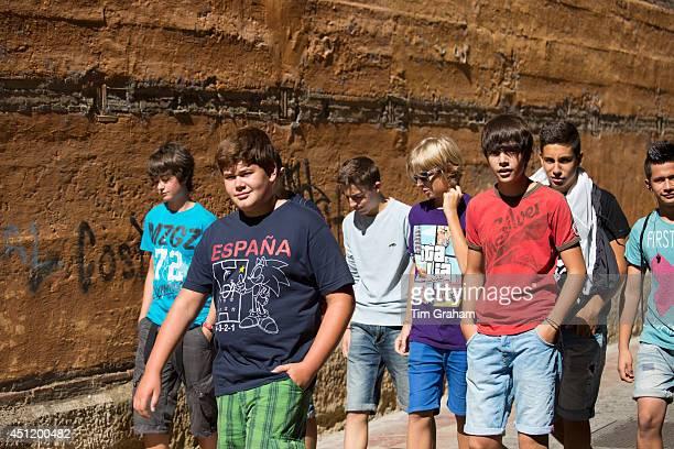 Young students strolling in Calle Sacramento in Leon Castilla y Leon Spain