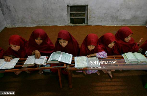 Young students study at the the women's School or Madrassa inside the compound of the Lal mosque on May 28 2007 in Islamabad Pakistan The Jamia Hafsa...