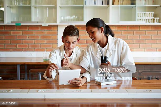 Young students using tablet in science class