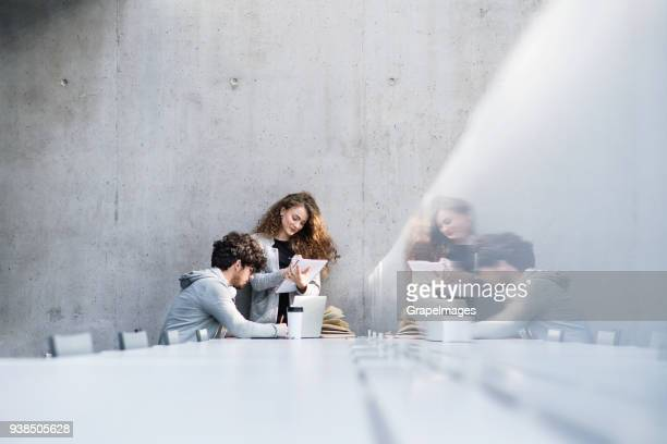 young students with laptop in a library. - wide stock pictures, royalty-free photos & images