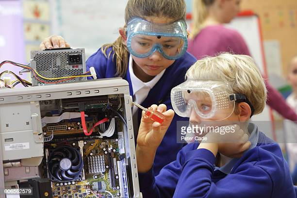 young students working in class - uniform stock pictures, royalty-free photos & images