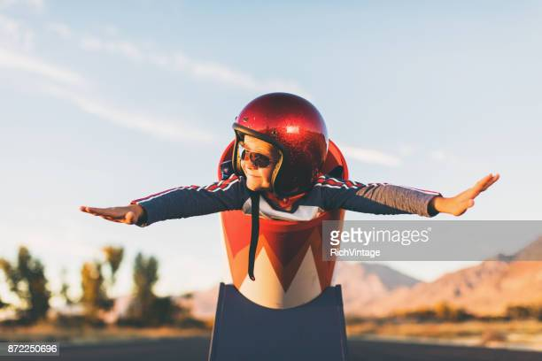 young stunt boy and human cannon ball - chance stock pictures, royalty-free photos & images