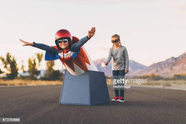 young stunt boy and human cannon ball - risk stock pictures, royalty-free photos & images