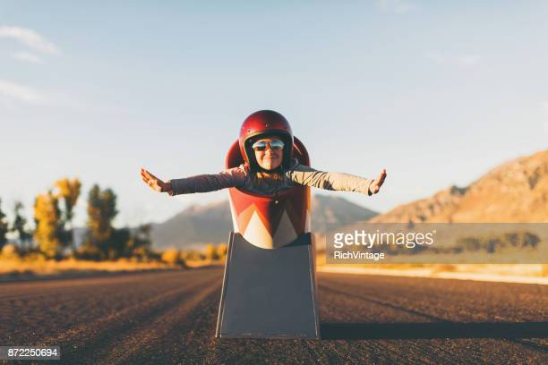 young stunt girl and human cannon ball - hero stock photos and pictures